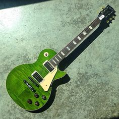 Now THIS is how you celebrate St. Patrick's Day!! - #gibson #lespaul #guitar #HappyStPatricksDay #green (at Gibson Showroom)