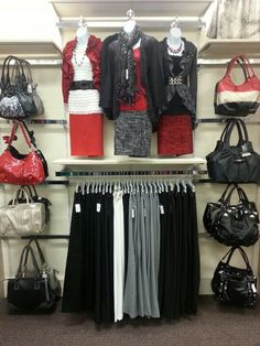 Purse selector in apparel wall.