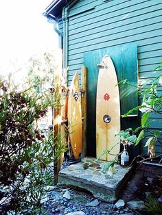 outdoor shower made of surfboards.