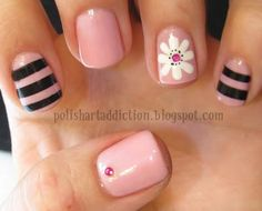 Create this stripes and flowers manicure for a cute and soft look.