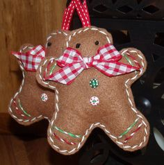 felted gingerbread ornaments.  I like the laced running stitch in red and white around the edges.