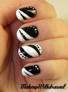 BLACK and WHITE nails!!!!! These would look great with a plain colored dress with black accents or a white dress!!!!! I wonder if they would do this for me at a nail salon......?