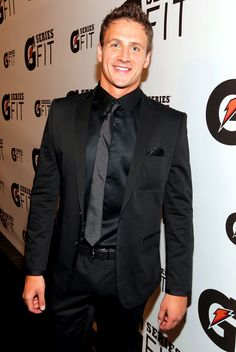 Ryan Lochte. he almost looks better in this kind of suit.