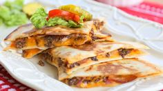 Quick and easy! Mexi Cheeseburger Quesadillas All of your favorite hamburger toppings nestled with cheese inside a tortilla Mexican Dishes, Mexican Food Recipes, Beef Recipes, Dinner Recipes, Cooking Recipes, Ethnic Recipes, Recipies, Yummy Recipes, Dinner Ideas