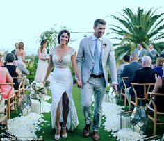 Michael Phelps and Nicole Johnson walked down the aisle in a lavish outdoor ceremony in Ca...
