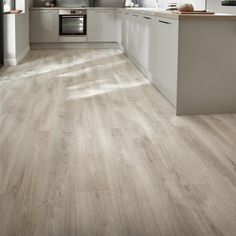 Howdens Professional Fast-Fit V Groove White Washed Oak Flooring - Create a light and serene look with our white washed oak laminate flooring. White Wash Wood Floors, Laminate Flooring In Kitchen, Laminate Flooring Colors, White Washed Oak, Wood Laminate, Light Oak Floors, Grey Oak, Timber Flooring, Vinyl Flooring