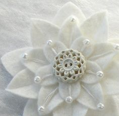 White on white Felt Flower pin with pierced white vintage button, embroidery and white pearl beads.