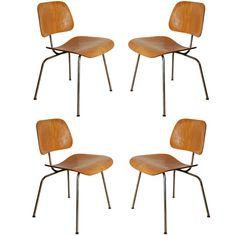 Set of Four Eames DCM Chairs