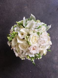 White bouquet with touches of green.