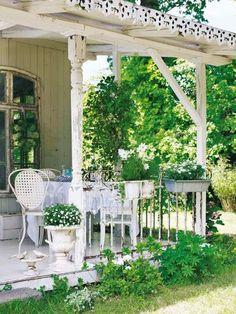 Pretty, shabby chic porch. Love it.