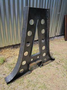 Metal factory table base. It looks like a giant A to me, so I like it twice.