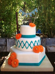 My first wedding cake!!! Lemon cake, lemon curd, raspberry jam, and vanilla buttercream.  Teal and orange dahlias.