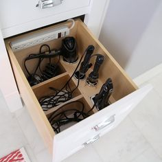 Amazing custom bathroom organizer for hair dryer and curling irons! #BathroomVanities