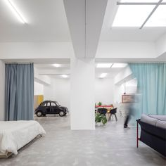 Completed in 2016 in Lisbon, Portugal. Images by Fernando Guerra | FG+SG . The project started with an unconventional request from an open minded couple: within a very tight budget, to convert a windowless 200m2 garage into...