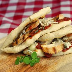 Grilled Parmesan Chicken Flatbread Sandwiches - homemade grilled flatbreads and even leftover grilled chicken can be used to make this quick and delicious summer sandwiches from the back yard grill. It's dinner in the palm of your hand!