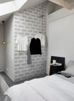 Is there anything more appealing than a fully monochrome bedroom with hints of colour here and there? Scroll right this way for some serious bedroom porn.