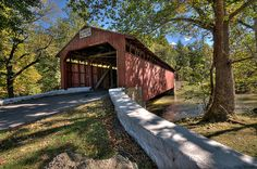 Little Gap Covered Bridge (Carbon County, PA)    This is one of two remaining covered bridges in Carbon County Pennsylvania. Little Gap Covered Bridge was thought to be built in either 1860 or 1880 (I've seen references to both years) utilizing a Burr Arch design and crosses the Buckwha Creek with a length of 92 feet. The bridge is open to daily vehicular traffic and is owned by the county.