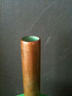 Cut water pipe, with an oxidised copper inside. Rather lovely.