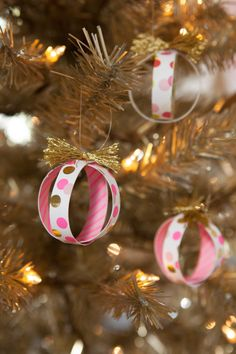 DIY graphic ball ornaments | Use leftover wrapping paper, magazines, postcards, you name it. Simply cut into strips and loop into circles, then secure with a little tape. Fit two together for a fun ball shape!
