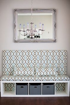 Perfect extra seating and storage for a little nook using a bookcase.. (I have everything about everything in this picture except the basic idea.. That fabric and chandelier/mirror combo can get out)