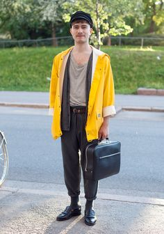 """Samuli, 22    """"I wanted to wear a rain jacket to not look too fashionable as I was coming to see a fashion show. I like loafers and carrot-shaped trousers."""""""