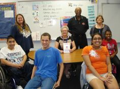 HEAD OF THE CLASS: Helen Pastore, seated at center with some of her high school and adult students and classroom staff, has been named the Florida Council ...