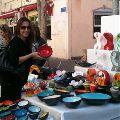 You can shop till you drop in Tel Aviv Israel.  Here's a friend at Nahalat Binyamin, Tel Aviv's open-air arts and craft market.
