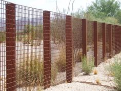Wire Mesh fencing around this golf course designate the course boundries.