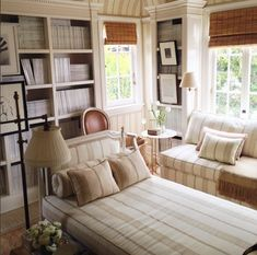 Mark Sikes Library. Subtle stripe used generously throughout library. Daybed centered within room.