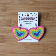 Bright Rainbow Large Heart Pride Earrings handpainted | Etsy Bamboo Plywood, Rainbow Heart, Brand Board, Posca, Hand Coloring, Pastel Pink, Laser Cutting, Sustainability, Pride