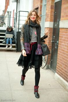 winter outfit - tasseled scarf worn with stripe tshirt, sheer a-line skirt, distressed brown leather jacket, leggings + chic ankle boots with oxblood fur