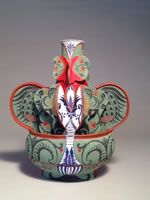 Andrea Gill: Her work is decorated, often employing hand-cut stencils, which generate stunning layers of color and glaze on clay vessels that allude to the history of ceramics, textiles, painting and ornament.