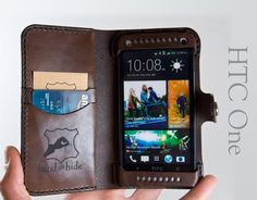 Leather HTC One Wallet / Leather HTC One Case  Free by HANDandHIDE, $ They make these for iphones too with custom engravings. Don't want plastic flimsy cases anymore? Check out this guys work.