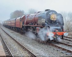 6233 Duchess of Sutherland at Hellifield carrying the Prince of Wales coat of arms headboard awaits departure with the Royal Train on 22nd March 2005.