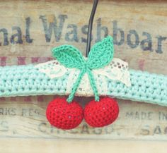 A sweet red cherry crocheted hanger new in the shoppe!