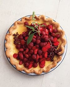 Lemon-Basil Custard Pie with Red Berries CRUST 1 1/4 cups all-purpose flour, plus more for dusting 1/2 teaspoon coarse salt 1/2 teaspoon sugar 1 stick cold unsalted butter, cut into small pieces 2 to 4 tablespoons ice water FILLING 1 cup milk 1 cup heavy cream 2 lemon-basil sprigs, plus more, with flowers, for serving 5 large egg yolks 1/4 cup sugar 2 teaspoons cornstarch 1/8 teaspoon coarse salt