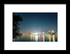 Toronto Night Skyline Framed Print by Mc. All framed prints are professionally printed, framed, assembled, and shipped within 3 - 4 business days and delivered ready-to-hang on your wall. Choose from multiple print sizes and hundreds of frame and mat options.