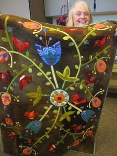 This design from Sue Spargo would be cool on my antique wool army blanket!