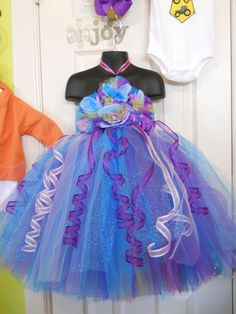 little mermaid inspired tutu dress.- love the curled ribbon.  could do that as seaweed scarf for half marathon?