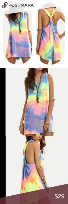 Tie Dye knotted back shift dress Preorder Bright and flirty tie dye shift dress with knotted back. 🔥 Please note this is a pre-order item. Expected arrival at the end of March. I am offering a 10% discount on pre-ordered items.🌸these come direct from my distributor without tags, shipped in clear plastic bag… No tag. CATEGORY WomenDressesMini COLOR Dresses Mini