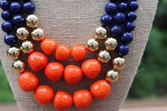 Peach Roots - Libby Navy and Orange Game Day Necklace, $27.00 (http://peachroots.com/libby-navy-and-orange-game-day-necklace/)