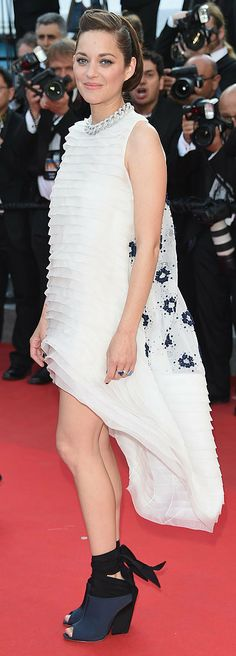 Marion Cotillard in Christian Dior and Chopard jewelry at the Two Days, One Night premiere.