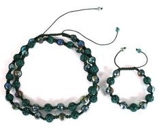 Shamballah Hunter Green Macrame Necklace and Bracelet Matching Jewelry Set with 12mm Iced Out Disco Balls JOTW. $19.95. The necklace has 20 iced out two tone disco balls and 23 plated disco balls.. This iced out macrame matching jewelry set includes 1 necklace and 1 bracelet.. The bracelet has 5 iced out two tone disco balls and 6 plated disco balls.. Great Quality Jewelry!. 100% Satisfaction Guaranteed!