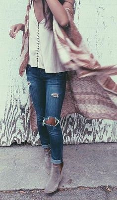 A short sleeve silk blouse, flowing patterned kimono, distressed denim, and great suede ankle boots.  Fall Boho is hot!