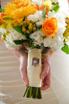 Locket on flower bouquet with photo of bride and her late father. The Tidewater Inn Wedding, Easton Maryland, getting ready photo coverage of Kelsey and Jonnie by wedding photographers of Leo Dj Photography. http://leodjphoto.com