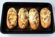 Delicious creamy garlic cheesiness stuffed into petit pains and baked until golden brown.