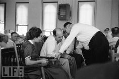 The accused killers of Emmett Till consulting at his trial.