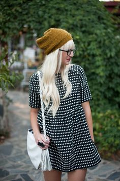 very chic yet retro at the same time. i like the beanie with the dress. never thought about putting those two together. hmmm...