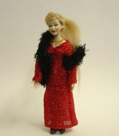 Lady in red dress with stole.  Heidi Ott 1:12 scale poseable doll.  $88 Canadian.  I wonder if anyone could change her feet into Barbie doll shape so that I could make high heels for her.