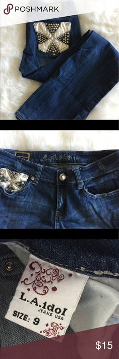 Bling pocket jeans La idol jeans.  Black and white leather and bling back pockets. Little signs of wear a tear on this pair. But that's is because they are so darn cute on. ;). These jeans run long. Just means they make the perfect cuff. LA Idol  Jeans Flare & Wide Leg